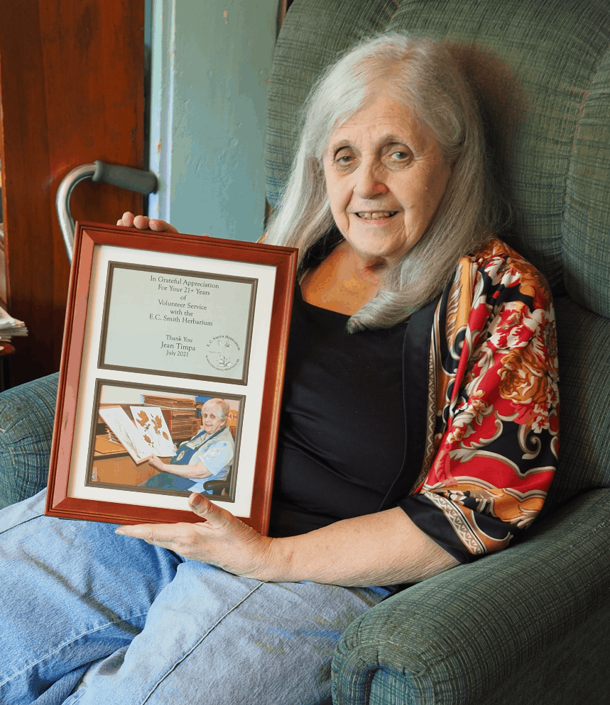 a photo of Jean holding her plaque